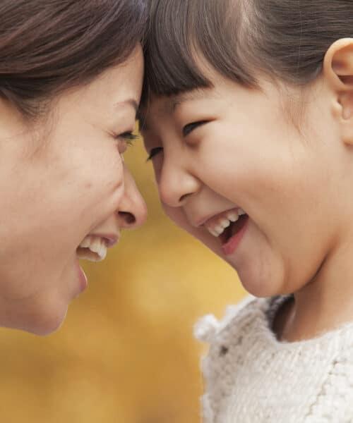 zorg - gelukkige moeder met kind